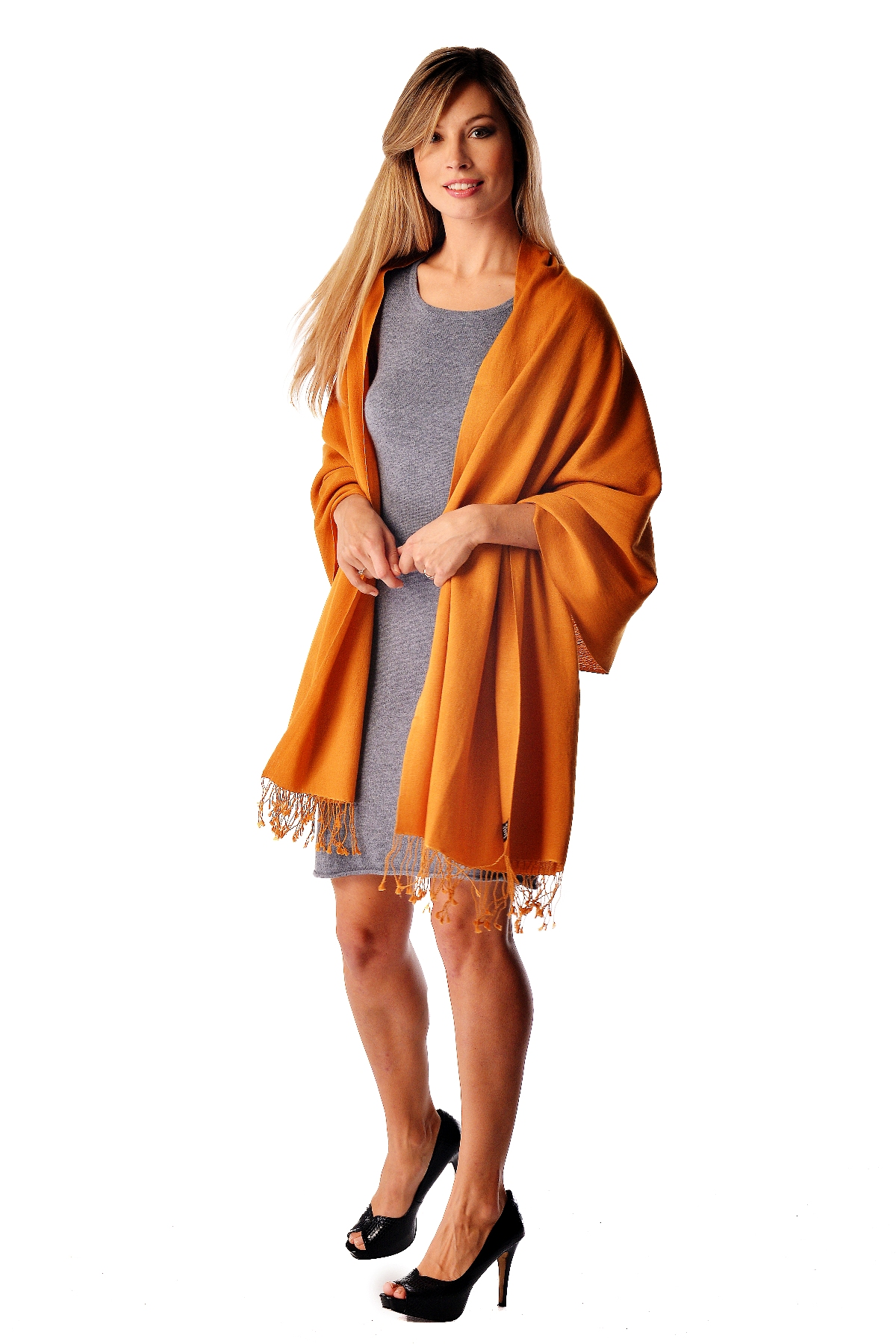 We offer the finest quality pashminas that are Made in Nepal. These wraps measure 28 inches x 80 inches  and are made with a blend of 70 cashmere and 30 silk. They come with 3 inch tassels at both ends. These pashminas are light  yet incredibly warm. Their innate versatility and  style  allows the wearer to use them as a scarf with a winter coat  an accessory  over a sweater or suit  a luxurious stole for formalwear  or just as the classic  pashmina wrap.