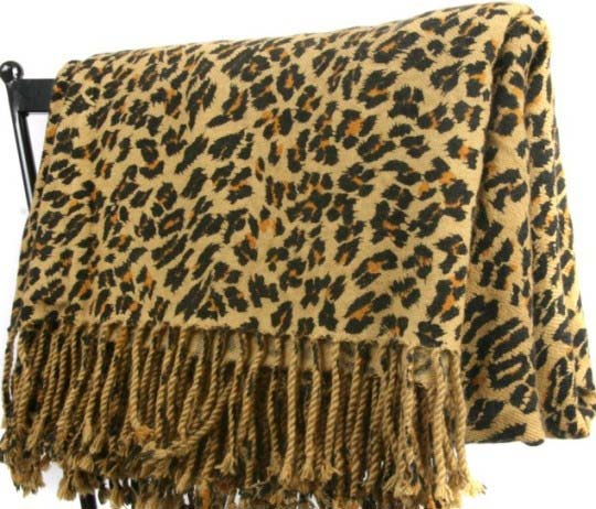 Nothing compares to cashmere for luxurious softness and warmth. These Leopard Print Cashmere Throws are made in Nepal from the finest 3 Ply  100 cashmere.  These beautiful cashmere throws measure 60 x 80  come with 4 tassels on both ends  and weigh 1.25 lbs.